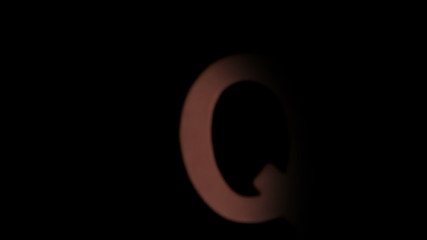 The letter q rising on black background