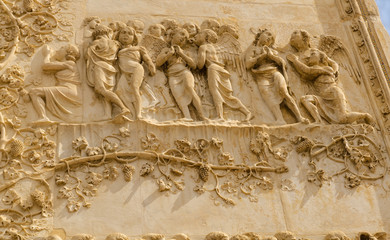 bas-relief, front of cathedral, Orvieto, Italy