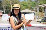 Women show Temporary Border pass at Dan Chedi Sam Ong poster