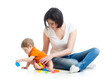 kid and mother play together with cup toys