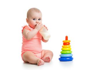 baby girl drinking milk from bottle