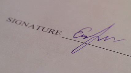 Close-up person putting signature, signing contract, macro