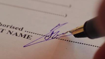 Extreme close-up signing documents, agreement, contract, macro