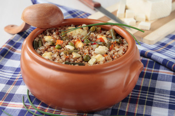Pot with buckwheat and vegetables