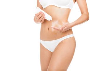 Woman applying moisturizer cream lotion on belly