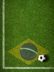 Soccer grass field with ball and flag of Brazil