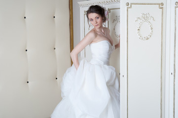 Smiling bride near closet