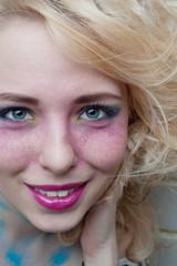 Smiling happy woman. Professional make-up. Blond hair