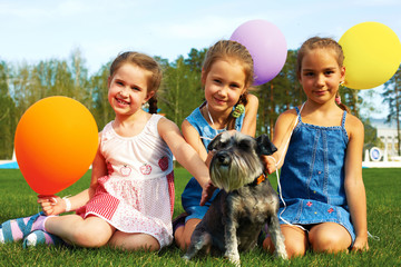 Group of happy girls with balloons
