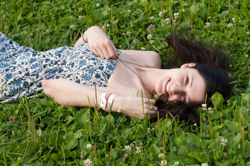 Girl lie on grass field