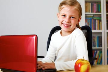 Schoolgirl working on a laptop