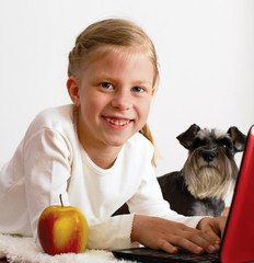 Schoolgirl studies at home on a laptop