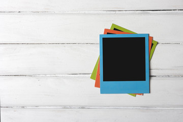 Color photo frames on planks of wood