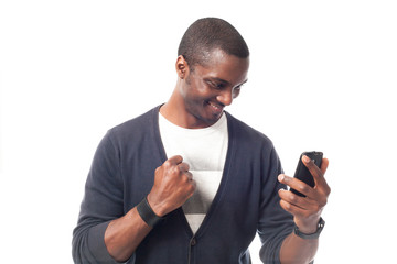 Smiling afro-american man with phone.