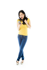 Angry young Asian woman shouting on a mobile phone