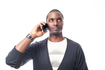 afro-american man at the phone. Isolated on white.