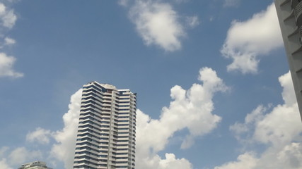 Buildings and Time Lapse Clouds