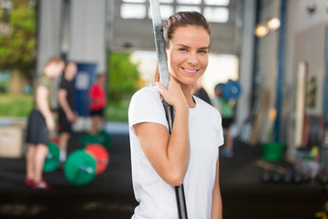 Attractive and smiling woman at crossfit center
