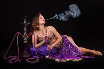 Belly dancer smoking hookah