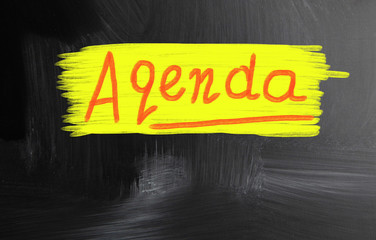 agenda handwritten with chalk on a blackboard