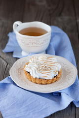 Tartlet with cream and cup of tea