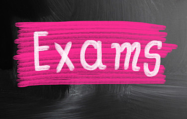 exams handwritten with chalk on a blackboard