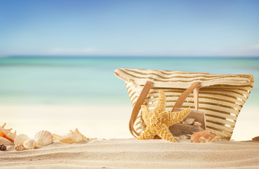 Summer beach with bag and shells