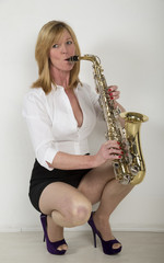 Woman playing a saxophone