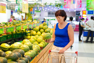 woman buys a watermelon