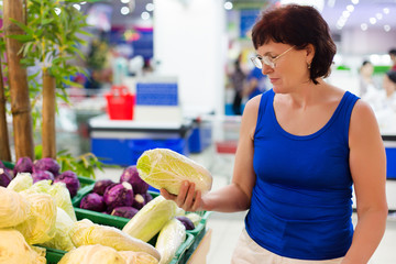 woman buys cabbage