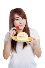 Asian girl eat strawberry and  roll cake
