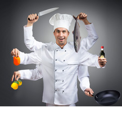 Humorous portrait of a chef with many hands