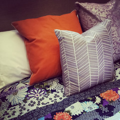 Colorful pillows on a bed