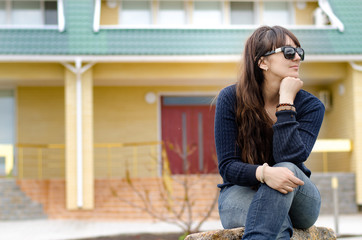 Middle-aged woman sitting thinking outdoors