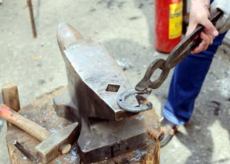 Blacksmith forges a souvenir  horseshoe