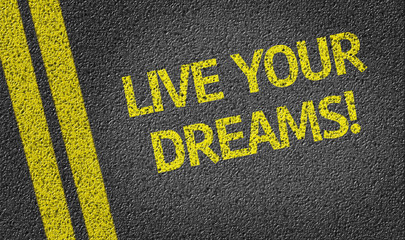 Live your dreams written on the road