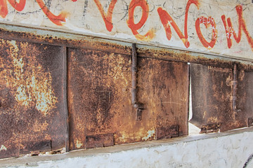 old rusty lock small window in a bunker of World War II