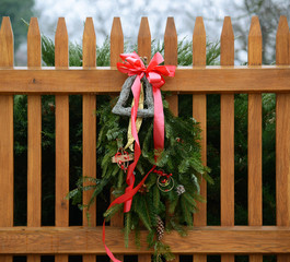 Seasonal Winter Christmas Wreath decoration on a fence