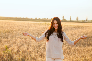 Beautiful lady in wheat field