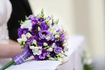 Wedding bouquet on kneeler in catholic church