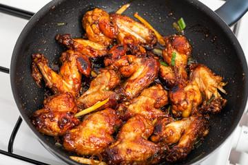 Chicken wings in a wok