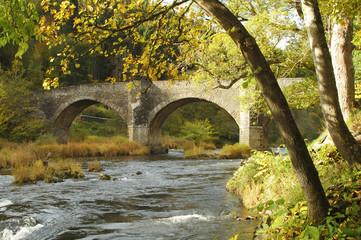 Yair bridge on the river Tweed in autumn