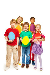 Happy kids holding egg shape colourful cards