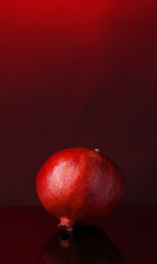 Ripe pomegranate on dark color  background
