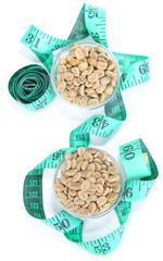 Raw green coffee beans and measuring tape, isolated