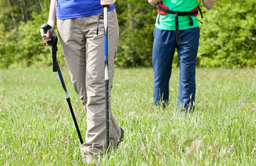 Legs of a young couple on country walk