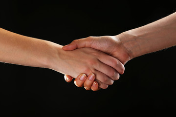 Handshake on black background