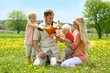 Happy Family of Four People Playing with Toys Outside in Flower