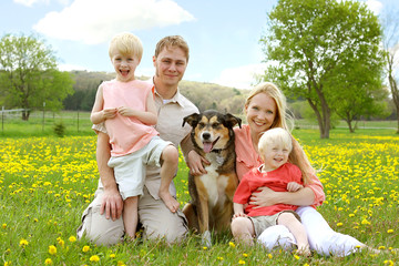 Happy Family Portrait in Flower Meadow