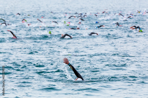 Triathletes at Ironman triathlon competition at Calella beach